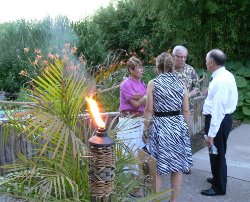 Guests enjoying the torchlit zoo during Cheers to 50 Years | Clyde Peeling's Reptiland