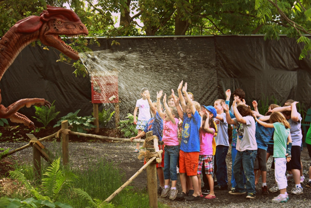 "Field trippers getting ""sprayed"" by Dilophosaurus in our Dinosaurs Come to Life exhibit"